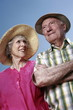 Senior couple with hats