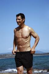 Male mature adult on beach