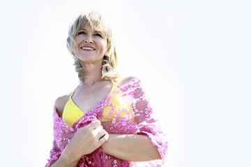 Female mature adult in bikini and shawl