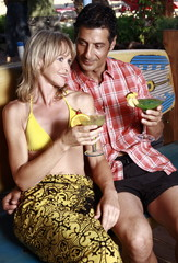 Mature adult couple with cocktails