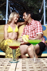 Mature adult couple sitting with cocktails