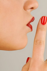 """""""Female young adult closeup;finger to lips"""""""