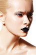 High fashion woman model. Silver make-up, black lips