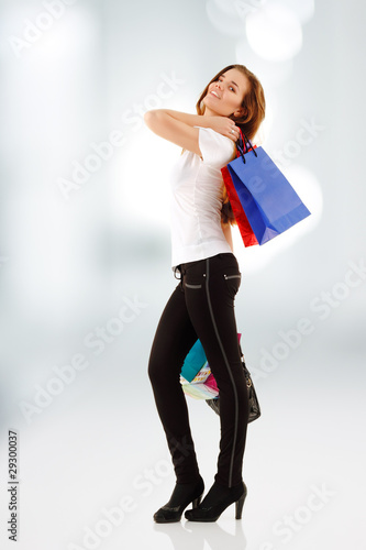 shopping teen girl smiling with bags
