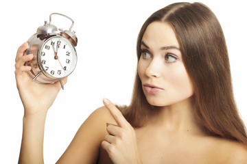 Portrait of the girl showing a finger on an alarm clock