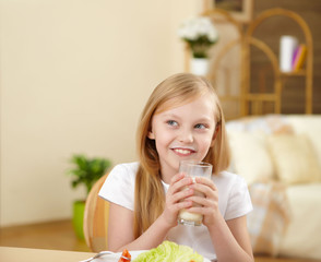 little girl having meal at home