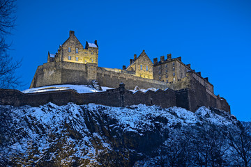 Edinburgh Castle, Scotland, UK, illuminated at dusk in winter