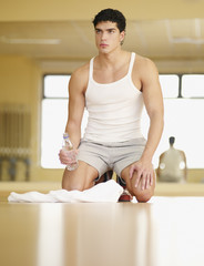 Man taking a break from working out in a fitness studio