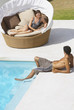 Man and woman sitting by pool