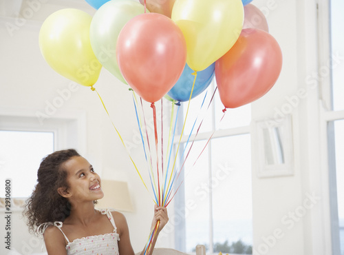 Girl with balloons smiling