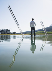 Man standing on water with ladders