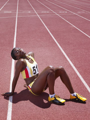 Racer sitting on a track with her head back