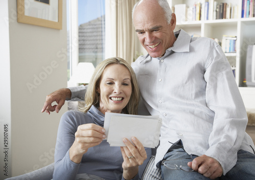 A couple looking at pictures
