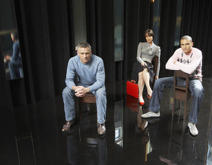 Three businesspeople sitting in an office