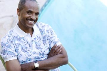 Man sitting by pool