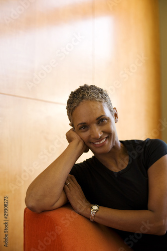 Woman sitting on sofa in modern home relaxing