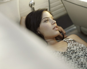 a woman lying in a car relaxing
