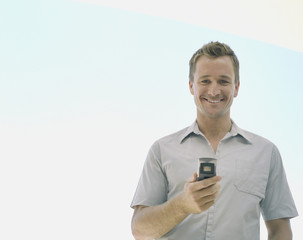 A man holding a cellular phone