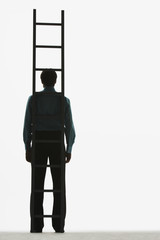 Man standing with a ladder balanced against him