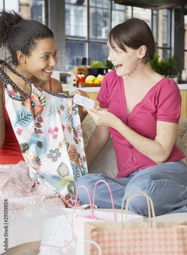 Two women with shopping bags and new clothes