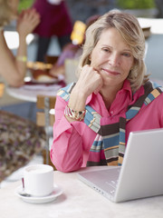 Woman on outdoor patio with laptop