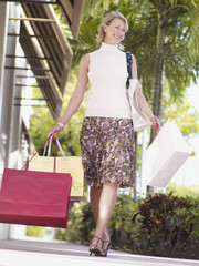 Woman outdoors with shopping bags