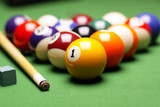 Billiard balls, cue on green table!