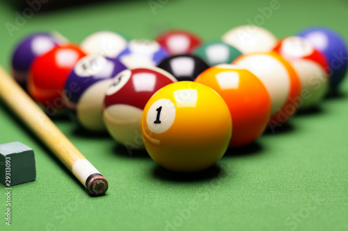 Billiard balls, cue on green table!