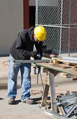 Worker Clamping Metal Stud