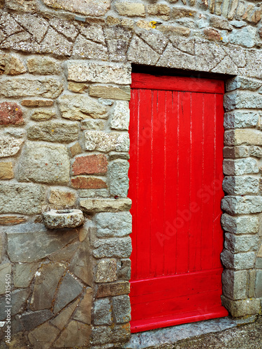 Red door with antique stone hitching post