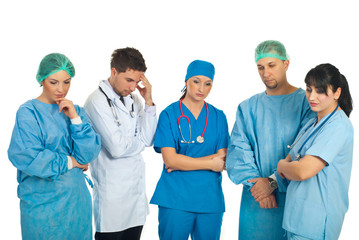 Sad doctors team
