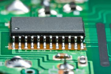 Black chip on green circuit board