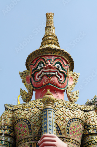 Giant statue in traditonal Thai style at Wat Phra Kaew