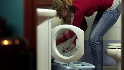 woman using washing machine, doing chores