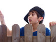 child talking to somebody on the other side of the fence