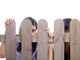 girls peeking through the fence