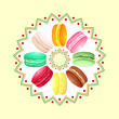 Colorful french macaroons twisted over round pattern
