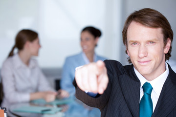 Businessman pointing at the camera