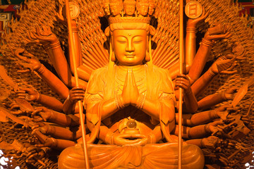 Thousand hands of god image make of wood carving in chinese temp