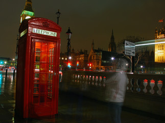 Red telephone box and Big Ben at night