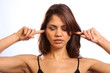 Fingers in ears do not want to hear from girl eyes closed