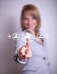 woman pressing social network icon