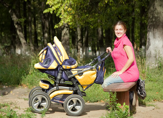 Woman with pram in park