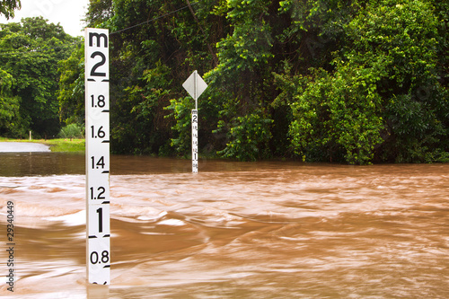Flooded road with depth indicators in Queensland, Australia - 29340449