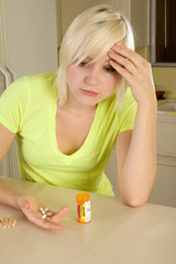 Young blond woman with medicine pills