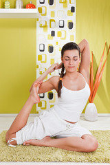 Beauty, young girl sitting in a yoga position