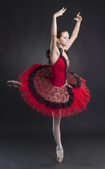 pretty ballerina posing in a red tutu
