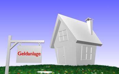 Haus mit Schild - Geldanlage