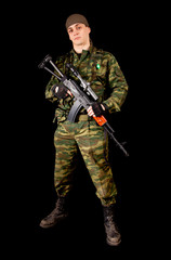 Soldier in uniform with weapon