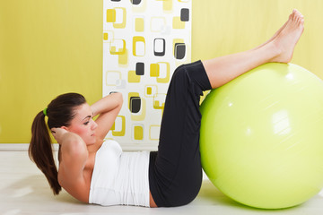 Beauty, young girl behooves gym exercise with ball